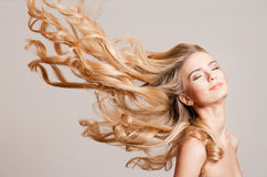 Blond beauty with amazing hair. stock photo
