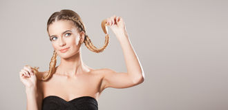 Blond beauty with amazing hair. Portrait of a young blond woman with long healthy hair stock photography