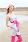 Blond beauty girl on the beach Stock Photography