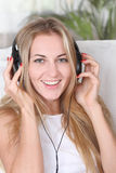 Blond beauty girl wearing headphones Stock Photos