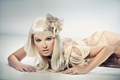 Blond beauty lying. And posing Royalty Free Stock Image