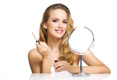 Blond beauty in makeup. stock photography