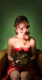 Blond beauty with present. Half length portrait of young blond holding present box with creative lighting Stock Photos