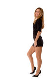 Blond beauty in a short black dress stock photos