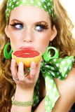 Blond Beauty With Grapefruit Royalty Free Stock Photos
