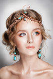 Blond beauty woman portrait with golden hair jewelry Stock Photo