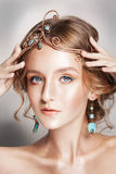 Blond beauty woman portrait with golden hair jewelry Royalty Free Stock Images