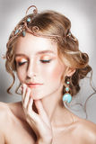 Blond beauty woman portrait with golden hair jewelry Royalty Free Stock Photos