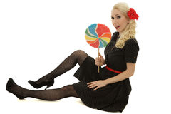 Blond with big candy Royalty Free Stock Photography
