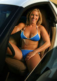 Blond bikini Babe with Corvette Stock Image