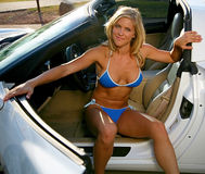 Blond bikini Babe with Corvette Stock Photo