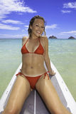Blond in bikini on paddle board Stock Photography
