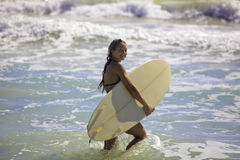 Blond in bikini with surfboard Royalty Free Stock Image