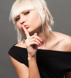 Blond in black Stock Image