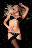 Blond in black lingerie covered in diamonds Stock Photos