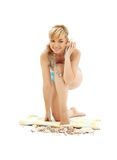 Blond in blue bikini with shell Royalty Free Stock Photography