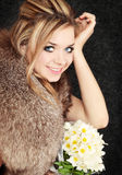 Blond  with the bouquet Royalty Free Stock Photos