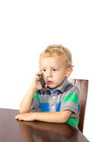 Blond boy anxiously talking. On cell phone Stock Images