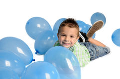 Blond boy with balloons on white background Stock Photo
