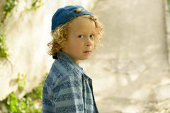 Blond boy with a blue cap Royalty Free Stock Photos