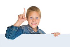 Blond boy, with blue eyes, pointing up. Fun boy in blue jeens, pointing up,expressing attention, isolated on white, horizontal Stock Image