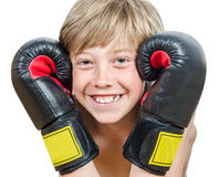 Blond boy with boxing gloves Royalty Free Stock Photos