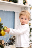 Blond boy in christmas interior Stock Photos
