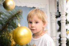 Blond boy in christmas interior Royalty Free Stock Photos
