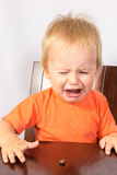 Blond boy crying Stock Photography