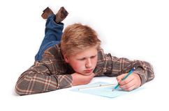 Blond boy drawing a picture Stock Images
