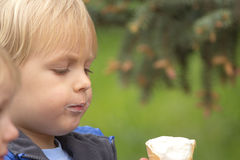 Blond boy eating ice cream Royalty Free Stock Photo