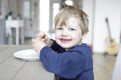 Blond boy eats jam Royalty Free Stock Photos
