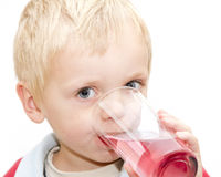 Blond boy having a drink Royalty Free Stock Photo