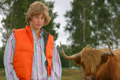 Blond boy with highlander Royalty Free Stock Photography