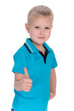 Blond boy holds his thumb up Royalty Free Stock Photo