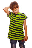 Blond boy kid in a striped green shirt is Royalty Free Stock Photos