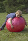 The blond boy lies on a relaxing balloon Stock Photography