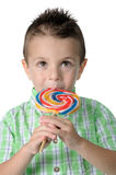 Blond boy with lollipop in her mouth Stock Photo