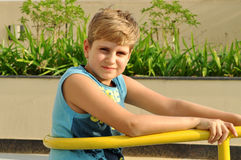 Blond boy looking at camera Royalty Free Stock Photos