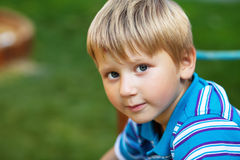 Blond boy outdoors. Horizontal outdoor portrait of a cute blond boy Royalty Free Stock Image