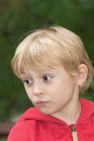 Blond boy outside Royalty Free Stock Image
