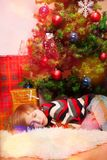 Blond boy overslept Santa Stock Photography