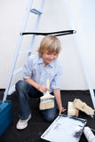 Blond boy painting a room with his parents Stock Photography