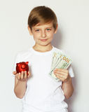 Blond boy with a pig piggy bank Stock Photography