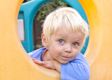 Blond boy playing in climbing frame Stock Photography