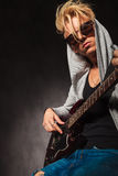 Blond boy playing electric guitar in studio Royalty Free Stock Photos