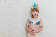 Blond boy playing injun Royalty Free Stock Image
