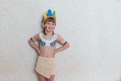 Blond boy playing injun Royalty Free Stock Photo