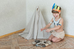 Blond boy playing injun Royalty Free Stock Photos