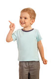 Blond boy pointing finger to the side Royalty Free Stock Photo